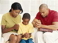 Parents with son (6-9) praying Stock Photo - Premium Royalty-Freenull, Code: 618-01887012
