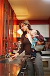 Woman with Baby in Kitchen    Stock Photo - Premium Royalty-Free, Artist: Masterfile, Code: 600-01887433