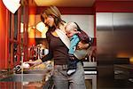 Woman with Baby in Kitchen    Stock Photo - Premium Royalty-Free, Artist: Masterfile, Code: 600-01887434