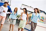 Group of Friends Walking on Boardwalk