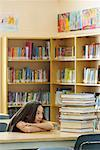 Student in Library, Looking at Stack of Books    Stock Photo - Premium Rights-Managed, Artist: Chris Hendrickson, Code: 700-01954515