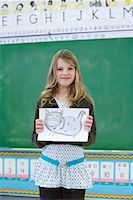 preteen girl pussy - Student in Classroom, Showing Drawing    Stock Photo - Premium Rights-Managednull, Code: 700-01954550