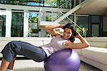 Woman Exercising in Living Room    Stock Photo - Premium Royalty-Free, Artist: Masterfile, Code: 600-01954827