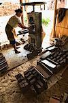 Woman Making Clay Roof Tiles, Central Java, Java, Indonesia
