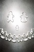 Gingerbread Man and Woman Cookie Cutter Family with Semicircle of Others    Stock Photo - Premium Rights-Managednull, Code: 700-01955419