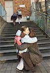 Mother Dropping Daughter Off at School, Paris, France    Stock Photo - Premium Royalty-Free, Artist: Masterfile, Code: 600-01956008