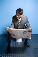 a reading busines man Stock Photo - Premium Royalty-Freenull, Code: 642-02005994