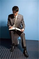a reading busines man Stock Photo - Premium Royalty-Freenull, Code: 642-02005995