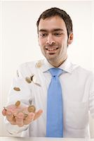 Man Tossing Coins    Stock Photo - Premium Royalty-Freenull, Code: 600-02010039