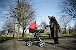 Woman Pushing Baby Carriage    Stock Photo - Premium Rights-Managed, Artist: Steve McDonough, Code: 700-02010355