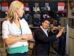 Couple with Television in Store    Stock Photo - Premium Rights-Managed, Artist: Matthias Tunger, Code: 700-02010604