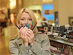 Woman Shopping for Cosmetics    Stock Photo - Premium Rights-Managed, Artist: Matthias Tunger, Code: 700-02010629