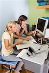 Friends looking at computer Stock Photo - Premium Royalty-Freenull, Code: 604-02043587