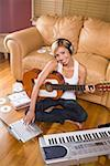 Woman guitarist recoding music Stock Photo - Premium Royalty-Free, Artist: F1Online, Code: 604-02043601
