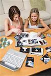 Young adult women looking at photographs Stock Photo - Premium Royalty-Free, Artist: Paul Eekhoff, Code: 604-02043632