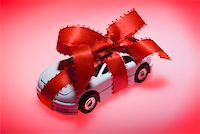 Toy car wrapped in ribbon Stock Photo - Premium Royalty-Freenull, Code: 604-02043841