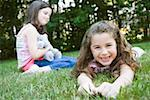Girls smiling in grass Stock Photo - Premium Royalty-Free, Artist: Kevin Dodge, Code: 604-02044191