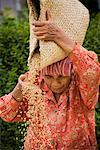Woman Winnowing Rice, Lingga, North Sumatra, Indonesia    Stock Photo - Premium Rights-Managed, Artist: R. Ian Lloyd, Code: 700-02046509