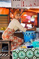 Woman at Market Stall, Bukittinggi, Sumatra, Indonesia    Stock Photo - Premium Rights-Managednull, Code: 700-02046587