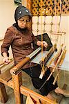 Woman Working at Loom, Pandai Sikat, Sumatra, Indonesia