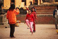 Children Skipping in Street, Kathmandu, Nepal    Stock Photo - Premium Rights-Managednull, Code: 700-02047005