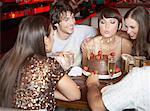 Five people having fun and smiling at a birthday party in a restaurant Stock Photo - Premium Royalty-Free, Artist: Masterfile, Code: 635-02051235