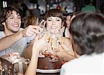 Group of people toasting and smiling at a birthday party in a restaurant Stock Photo - Premium Royalty-Free, Artist: Masterfile, Code: 635-02051274