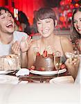Four people with birthday cake laughing at a party in a restaurant Stock Photo - Premium Royalty-Free, Artist: Jeremy Maude, Code: 635-02051278