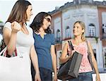 Three women outdoors with shopping bags smiling Stock Photo - Premium Royalty-Freenull, Code: 635-02051478