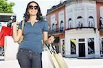 Woman outdoors with shopping bags smiling Stock Photo - Premium Royalty-Freenull, Code: 635-02051851