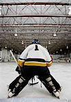 Rear View of Goalie During Hockey Game