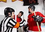 Referee Penalizing Hockey Players