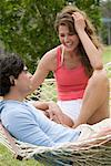 Couple in Hammock    Stock Photo - Premium Rights-Managed, Artist: Tim Kiusalaas, Code: 700-02063353