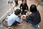 People Eating by Street Vendor, Hanoi, Vietnam    Stock Photo - Premium Rights-Managed, Artist: Sarah Murray, Code: 700-02063634