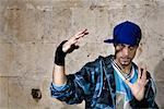 Male Hip Hop Dancer making Hand Gesture in front of Wall    Stock Photo - Premium Rights-Managed, Artist: Siephoto, Code: 700-02063816