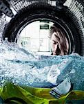 Man Looking at Piece of Paper in Washing Machine    Stock Photo - Premium Rights-Managed, Artist: Philip Rostron, Code: 700-02066112