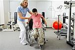Physiotherapist Helping Boy out of Wheelchair    Stock Photo - Premium Rights-Managed, Artist: Masterfile, Code: 700-02071749