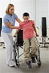 Physiotherapist Helping Boy out of Wheelchair    Stock Photo - Premium Rights-Managed, Artist: Masterfile, Code: 700-02071750