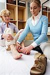Physiotherapist Examining Woman's Foot    Stock Photo - Premium Rights-Managed, Artist: Masterfile, Code: 700-02071788