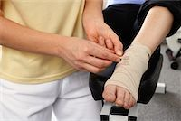 Close-up of Physiotherapist Examining Foot    Stock Photo - Premium Rights-Managednull, Code: 700-02071817