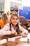 Portrait of Girl in Classroom    Stock Photo - Premium Rights-Managed, Artist: Norbert Kramer, Code: 700-02080339
