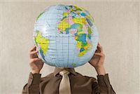 Businessman Holding Globe    Stock Photo - Premium Rights-Managednull, Code: 700-02080518