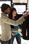 Two Women Shopping in Retail Clothing Store