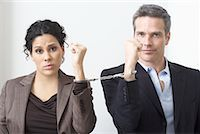Businessman and Businesswoman Handcuffed Together    Stock Photo - Premium Royalty-Freenull, Code: 600-02081773