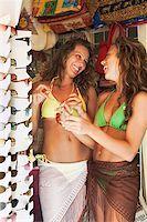 Teenage girls shopping for sunglasses Stock Photo - Premium Royalty-Freenull, Code: 621-02084975