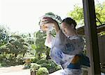 Woman wearing Yukata and fishbowl Stock Photo - Premium Royalty-Free, Artist: Aflo Relax               , Code: 670-02114920