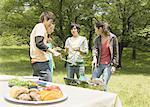 Young people barbecuing Stock Photo - Premium Royalty-Free, Artist: Photocuisine, Code: 670-02120258