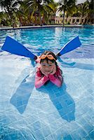 Girl Lying in Swimming Pool Wearing Goggles and Flippers    Stock Photo - Premium Royalty-Freenull, Code: 600-02121224