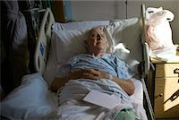 Man Lying in Hospital Bed    Stock Photo - Premium Rights-Managednull, Code: 700-02121242