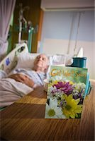 Elderly Man in Hospital with Get Well Soon Card on Table    Stock Photo - Premium Rights-Managednull, Code: 700-02121243